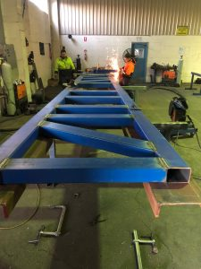 Eastland's staff manufacturing structural steel